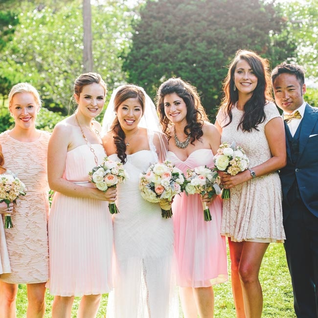 "When it came to bridesmaid dresses, Lisa asked each of her ladies to select a pale pink or nude dress that she wouldn't mind wearing again. ""Amazingly, without any coordination, they all picked dresses that were within the same color range,"" she says. ""I think they looked stunning together."""