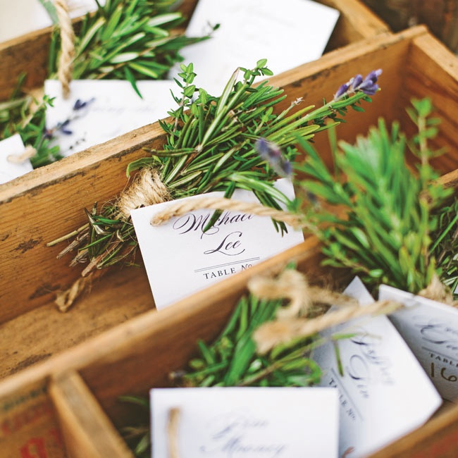Sprigs of lavender, tied with rustic twine, were attached to the elegant white escort cards.