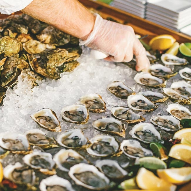During cocktail hour, guests noshed on sushi, lobster sliders and fresh oysters from the raw bar.