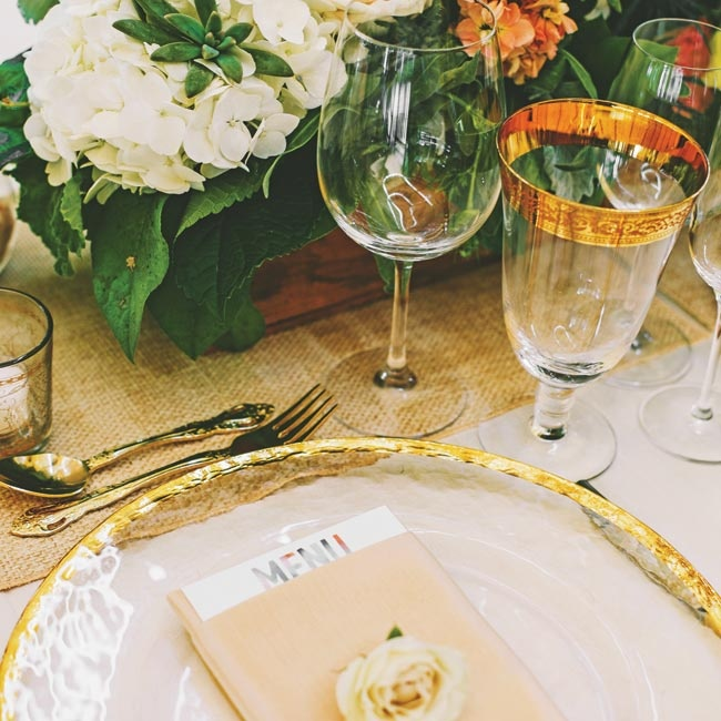 The elegant place settings had touches of gold on the chargers, wine glasses and flatware.