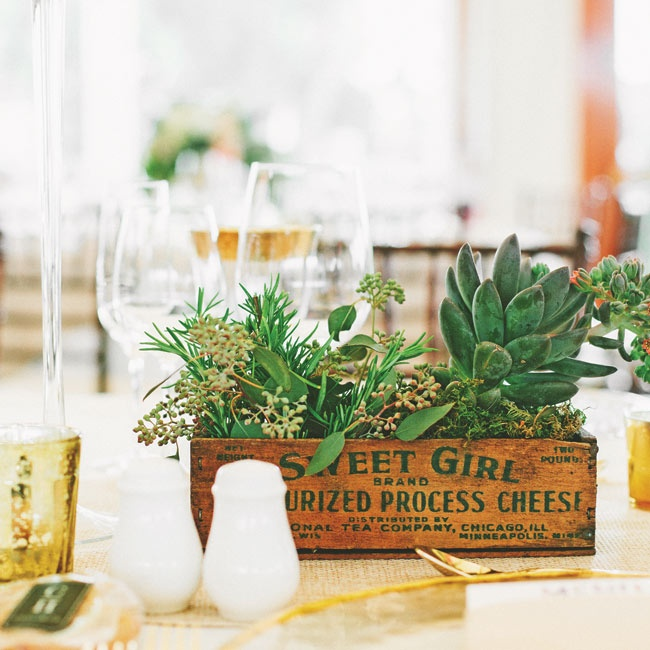 "The centerpieces were low vintage wooden boxes filled with roses, succulents, seeded eucalyptus, thistle, spider dahlias, dusty miller and grasses. ""I loved the soft and low-key, yet lush, feeling of all the pink and white tones offset with the earthier colors of the vintage boxes, burlap and gold,"" Lisa says."