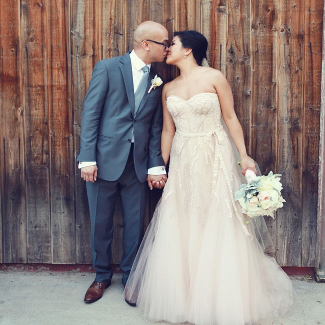 """Maria wanted her bridal look to be non-traditional, but still feel feminine and bridal. She chose the """"Candy"""" gown by Monique Lhuillier, a strapless, A-line gown in a soft blush hue. Delicate beading and geometric appliques added texture and a hint of playfulness to the dress."""