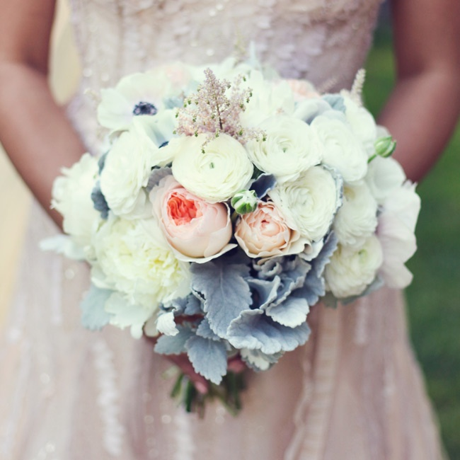 Maria filled her bouquet with silvery-white dusty miller and large blooms like peonies, garden roses and ranunculuses in soft shades of ivory and pink to complement the color of her gown.