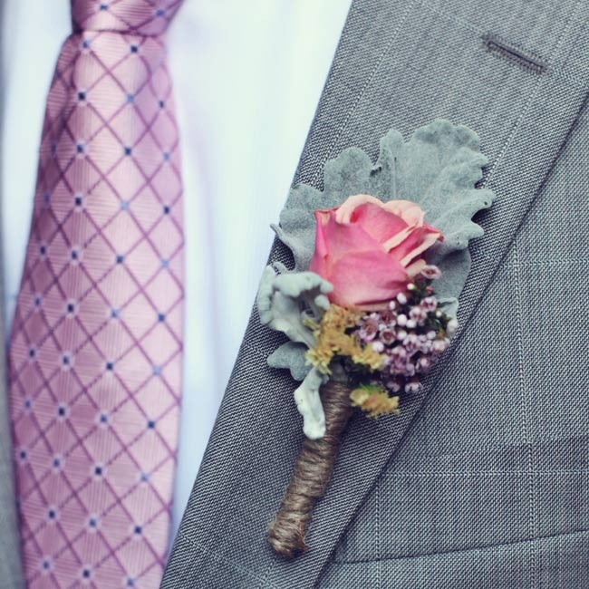 To complement Maria's bouquet, John wore a boutonniere made with a pink rose and dusty miller.