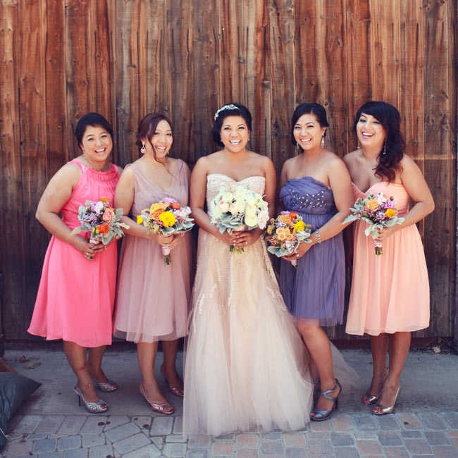 Maria's bridesmaids chose their own dresses, each in a different shade of pink and purple. Metallic heels tied into the day's color scheme and complemented Maria's look.