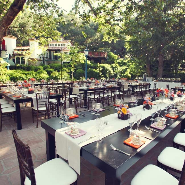 The reception took place in the courtyard at Rancho Las Lomas. The couple filled the space with long black polished Italian wood tables. Strings of bistro lights were hung over the space to offer a warm, festive glow as the evening went on.