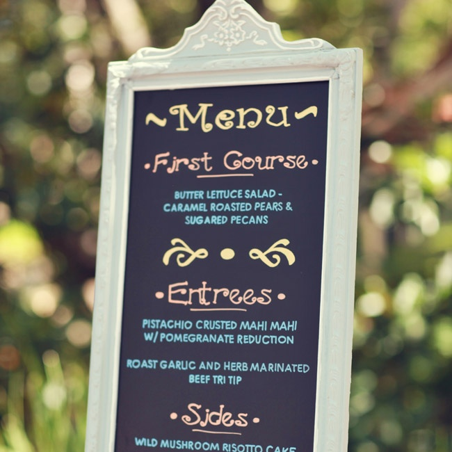 Instead of individual menu cards, the couple chose to display the menu on an elegantly framed chalkboard sign.