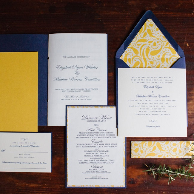 The simple white and navy invitations with yellow patterned envelope liner were the inspiration for the rest of Ryan and Matthew's wedding stationery.