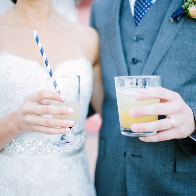 Even the signature cocktails and straws matched the wedding's navy and gold color palette.