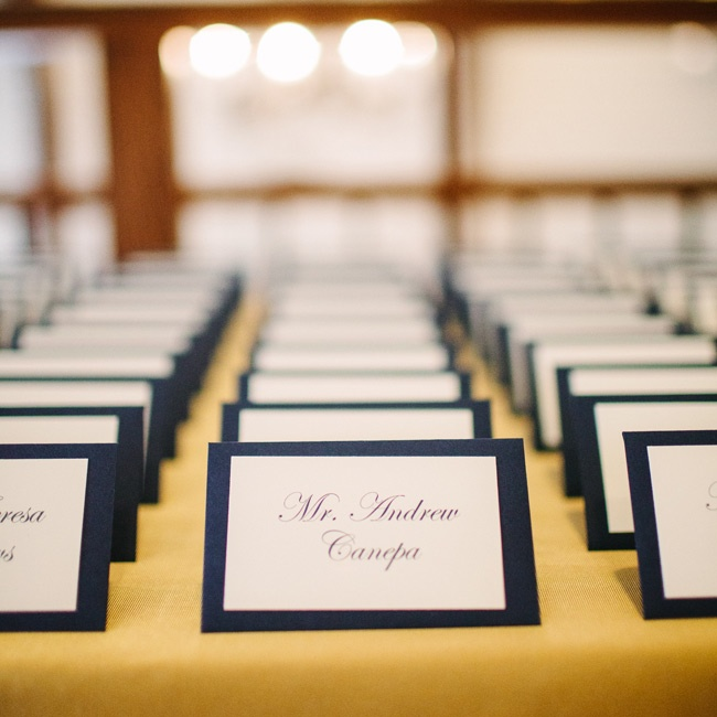 The escort cards looked simple, and they popped when displayed on a gold tablecloth.