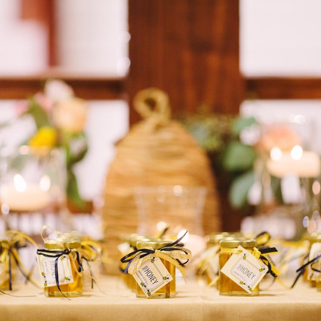 "Jars of honey tied with navy and yellow ribbon that said ""Sweeter Than Honey"" were the favors."