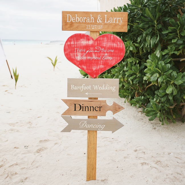 Home made wooden signs told guests where to go for the ceremony, the dinner and dancing.