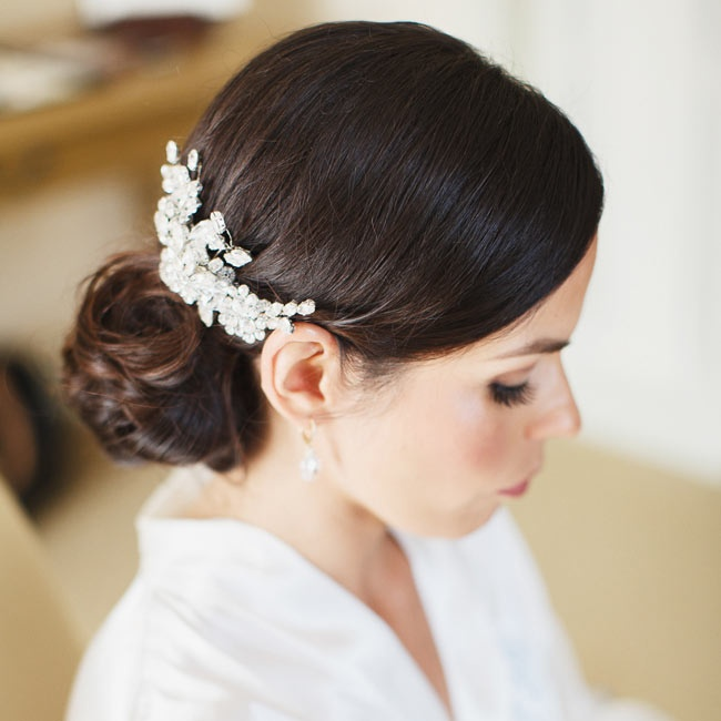 Deborah wore a floral design crystal hair pin with her sleek, low updo.