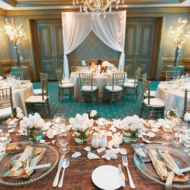 The indoor reception played upon the natural color scheme from the ceremony with a green, white and gold palette.