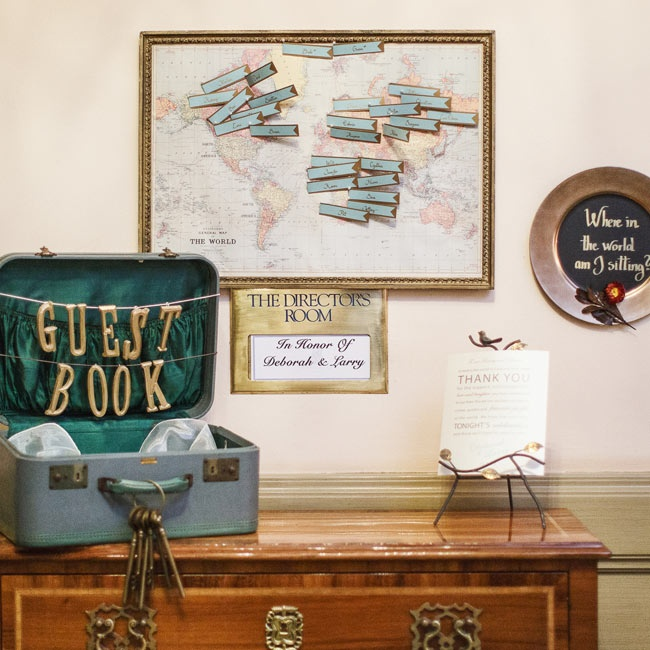 The couple incorporated a travel theme into their destination wedding, including fun details like a map-themed guest book and antique suitcase decor.