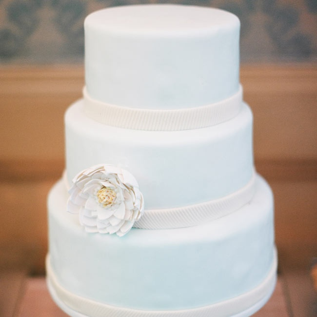 The wedding cake was a pale, soft blue with ribbons of white fondant running around the base of each tier.