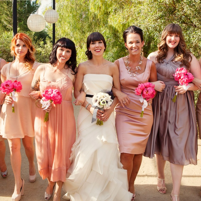 The bridesmaids chose their own dresses in shades of blush, pink and dusty purple.