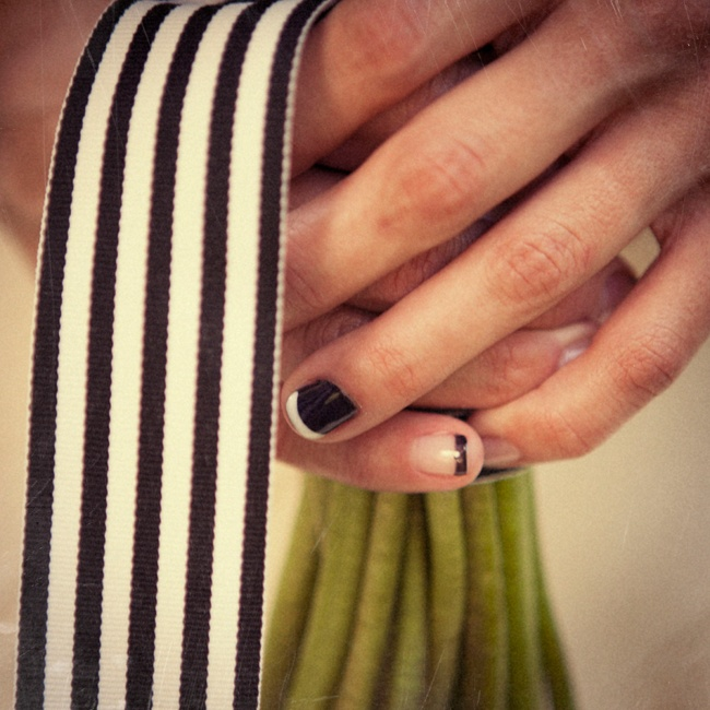 For cool modern look, Ashley opted for a french manicure with black and white nail polish.