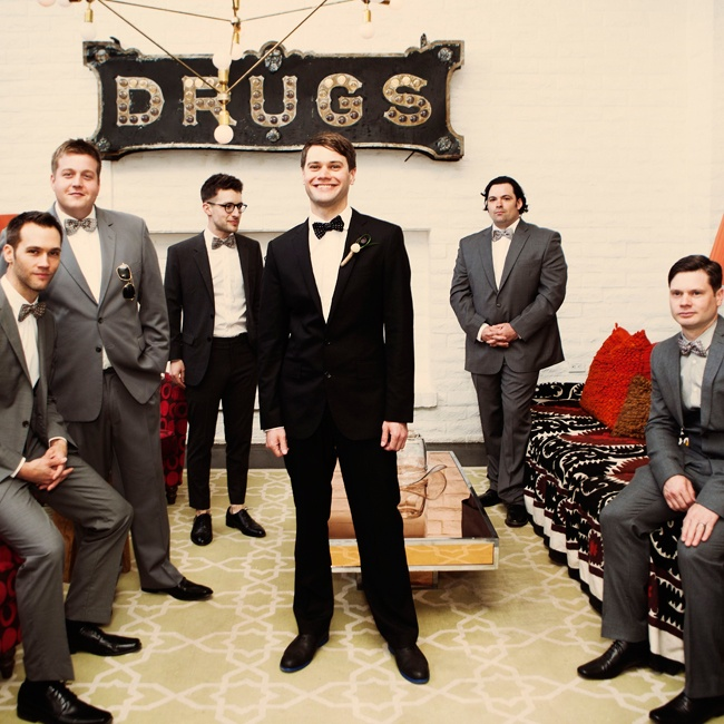 Ashley is a designer at J.Crew, so it was only fitting that Steve and his groomsmen wore black and gray suits from the company with matching bow ties.