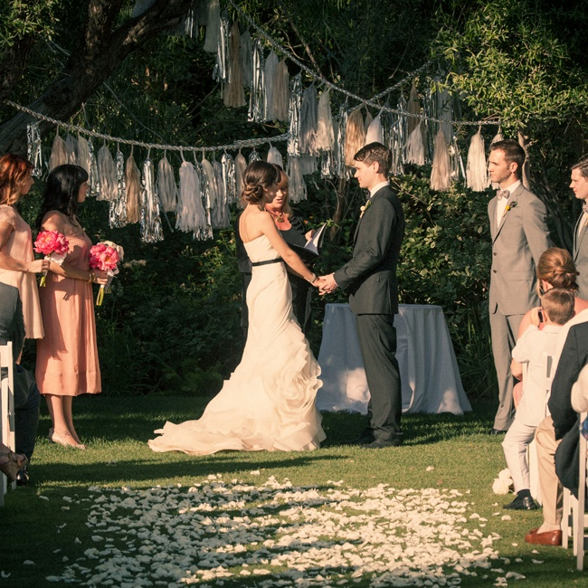 """We are obsessed with Confetti System's tassel garlands!"" says Ashley. ""After the wedding, we hung ours over our bed."""
