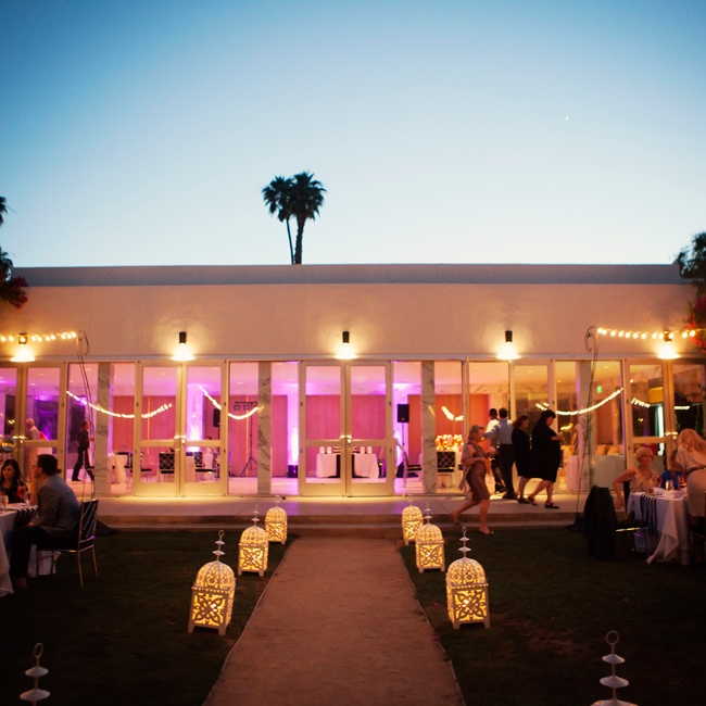 The walkway was lined with larger versions of the white lanterns that made up the centerpieces. They cast a warm glow over the space as the sun began to set.