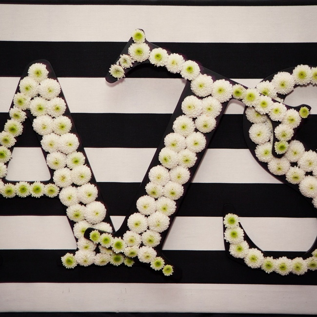 The couple's monogram was made using white and green button mums.