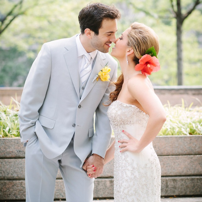 Rob chose a light fray suit to complement the silver hue of the bling covering Misty's gown. Big blooms—her hair piece and his boutonniere—made their glam attire a little playful.