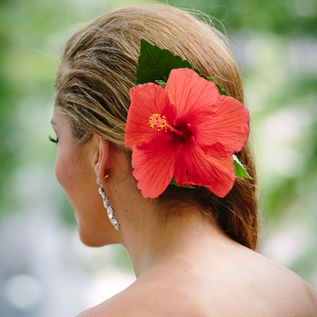 Misty wore her hair in loose curls pulled to one side, with a huge red hibiscus bloom pinned on the opposite side.