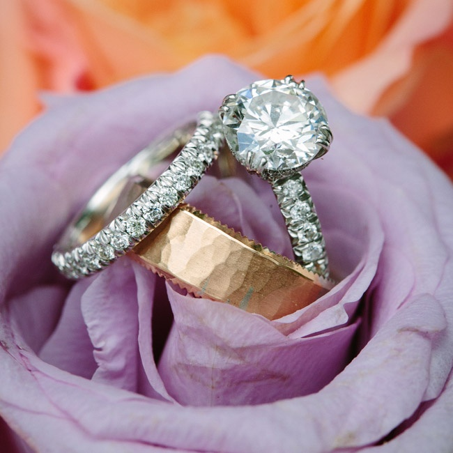Carey chose a wedding band that matched the one on her engagement ring, and Jim picked a textured gold band.