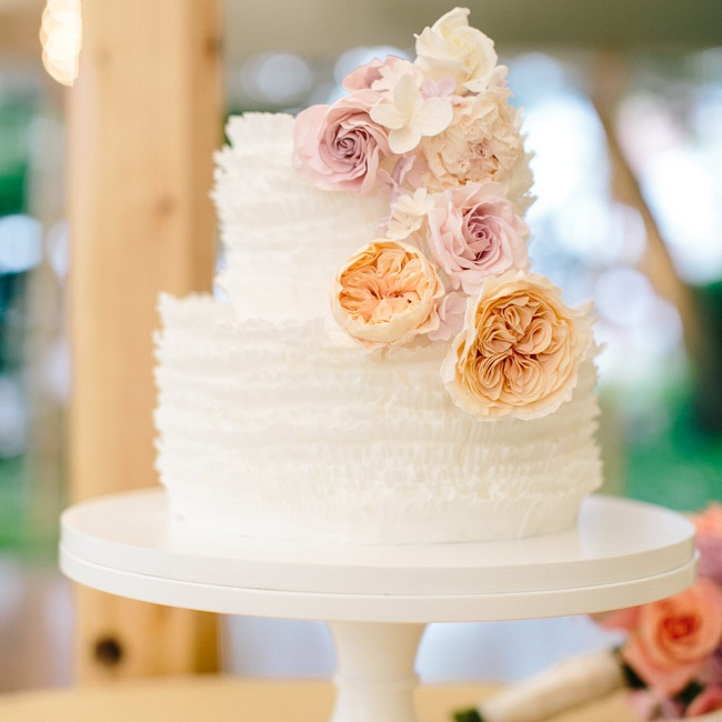 """I wanted a soft, delicate, simple look to the cake,"" Carey says. ""The sugar flowers were absolutely stunning and artistic!"""