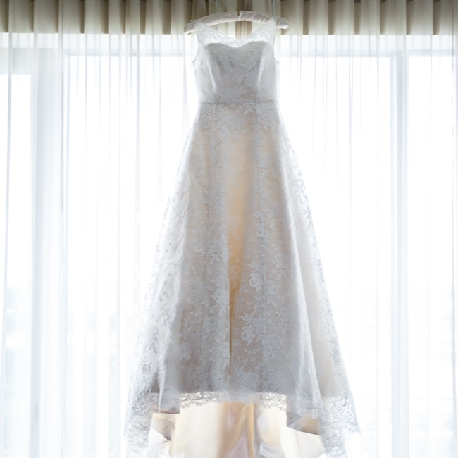 Katherine purchased her Elizabeth Todd gown in London, U.K. while working abroad. The A-line dress is ivory satin with a lace overlay and a boat neckline.