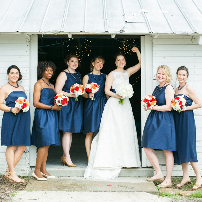 The bridesmaids wore two styles of navy blue dresses. The bride gave them Kenyan Kazuri jewelry, or ceramic-beaded necklaces and bracelets, to wear as well.