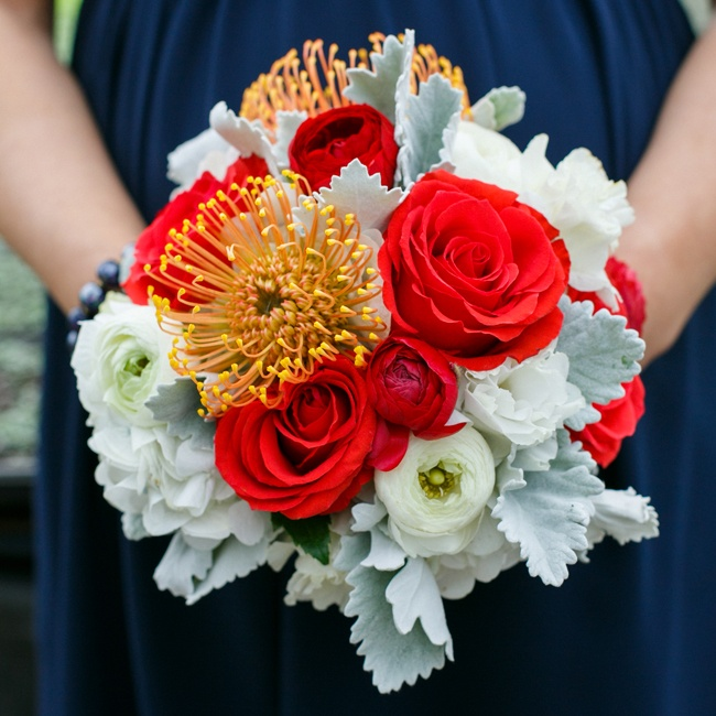 Red roses and white ranunculuses and peonies completed the Americana bridesmaid look.