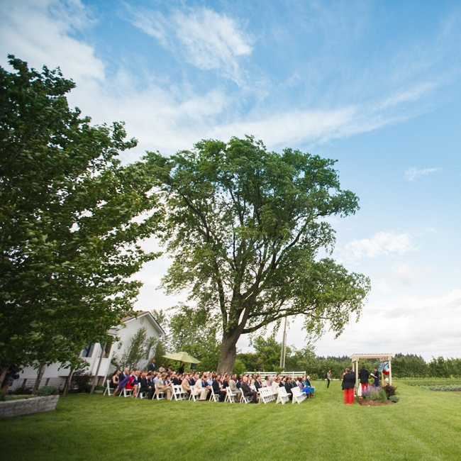 """We are definitely city folk, but the farm venue just felt right,"" Katherine says. Although it rained later in the day, the weather was beautiful for their evening ceremony."