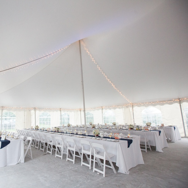 Farm-style tables with white linens and white folding chairs created a clean look under the tent.
