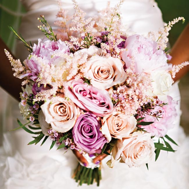 """""""There's simply no better combination than flirty pink astilbe, pink peonies and pink, lavender and cream roses,"""" Tosca says of her bountiful bouquet."""