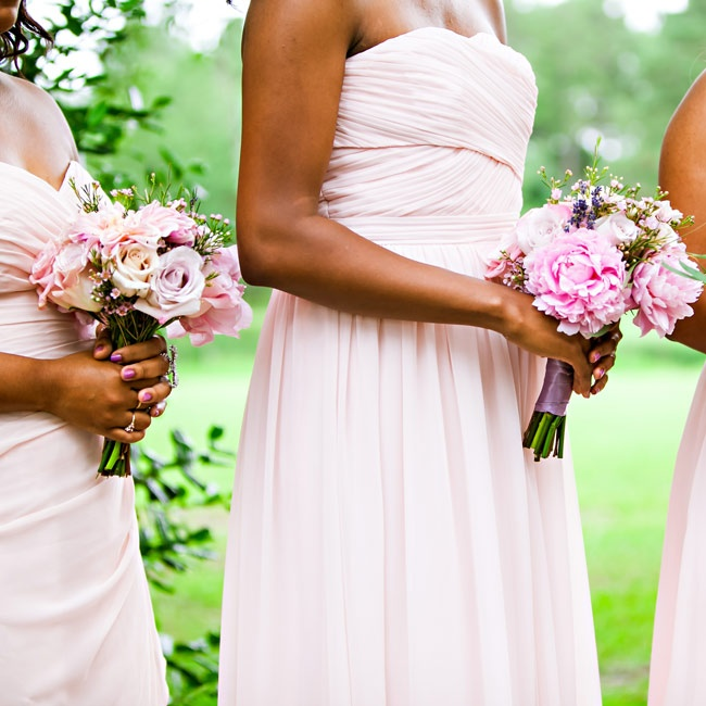 A simple combination of blush peonies and roses, accented with waxflower and lavender, made up the bridesmaid bouquets.
