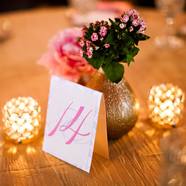 Glowing candles surrounded the centerpieces, which were placed next to tented table number cards.