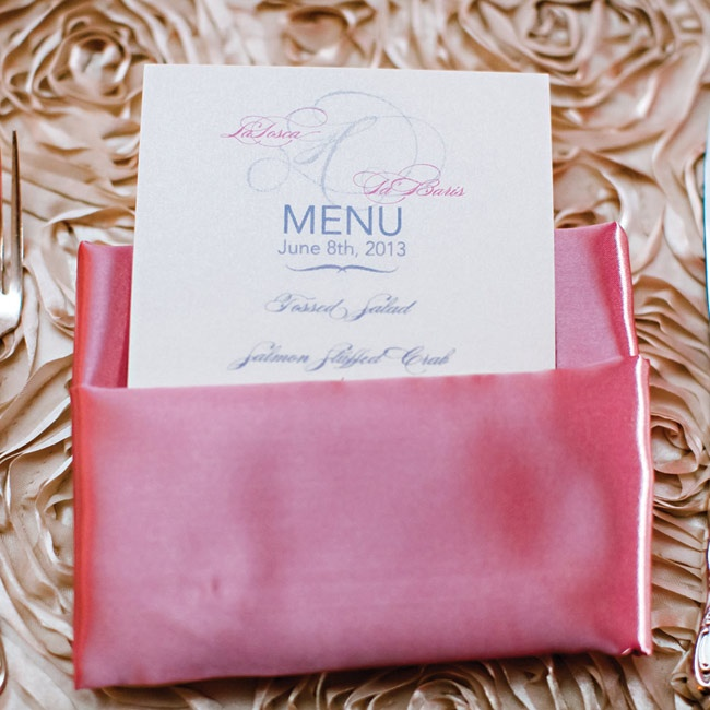 Tosca wanted a modern and contemporary look for the placesettings, so she chose pink satin napkins with the menus and silverware tucked inside.