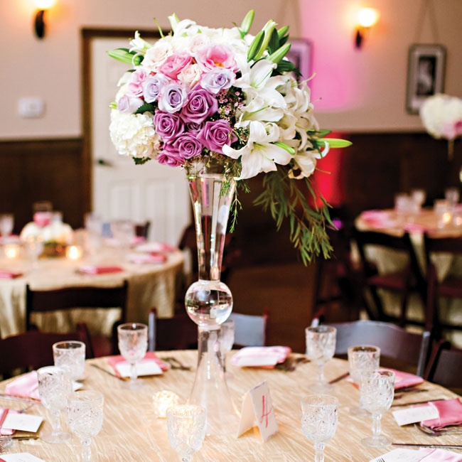Tall centerpieces overflowed with lush roses, lilies, hydrangeas and waxflowers in shades of lavender and pink.
