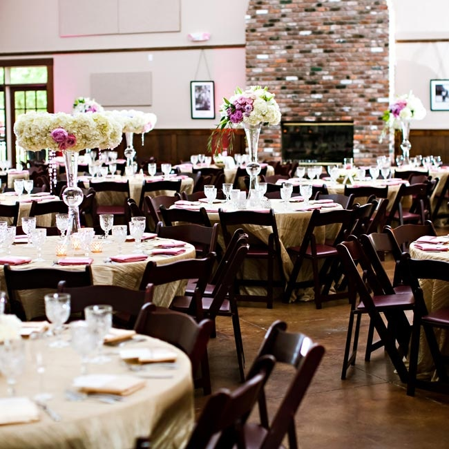 Gorgeous linens and dark wood chairs combined with the lush centerpieces to create an upscale, contemporary ambience at the reception.