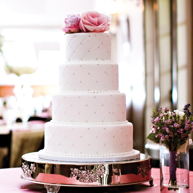 """Two layers of the cream-cheese-and-fondant-frosted cake were vanilla, while the other two were red velvet. """"I thought it would be nice for the guests to choose their favorite flavor,"""" she explains."""
