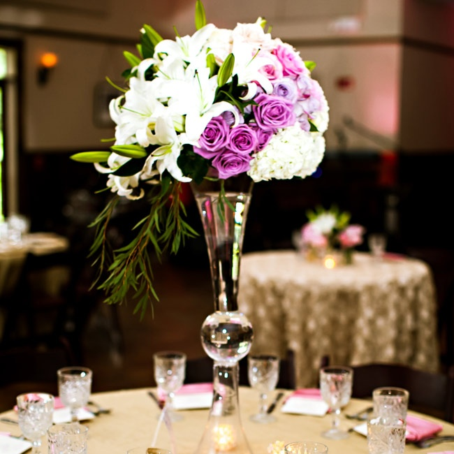 An ombre design could be see in the centerpieces, which were made up of lilies, hydrangeas, roses and eucalyptus leaves.