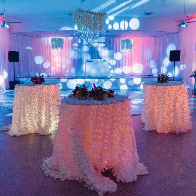 High-top tables, which were uplit and dressed with petal linens, surrounded the dance floor.