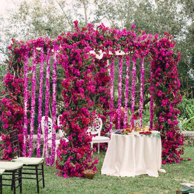 The mandap was decorated with magenta bougainvilla and accents of jasmine. Indhu's grandmother designed a kolam, a south Indian design made with flowers that brings good luck during auspicious occasions, that was placed in front of the mandap.