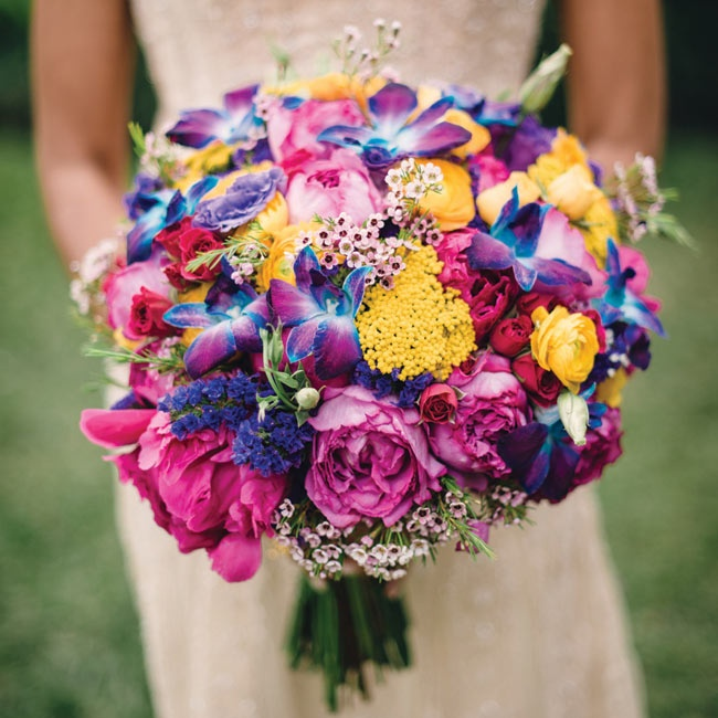 Indhu carried a knockout bunch of yellow ranunculus, statice, pink wax flowers, blue orchids, purple lisianthus, craspedia and spray roses.