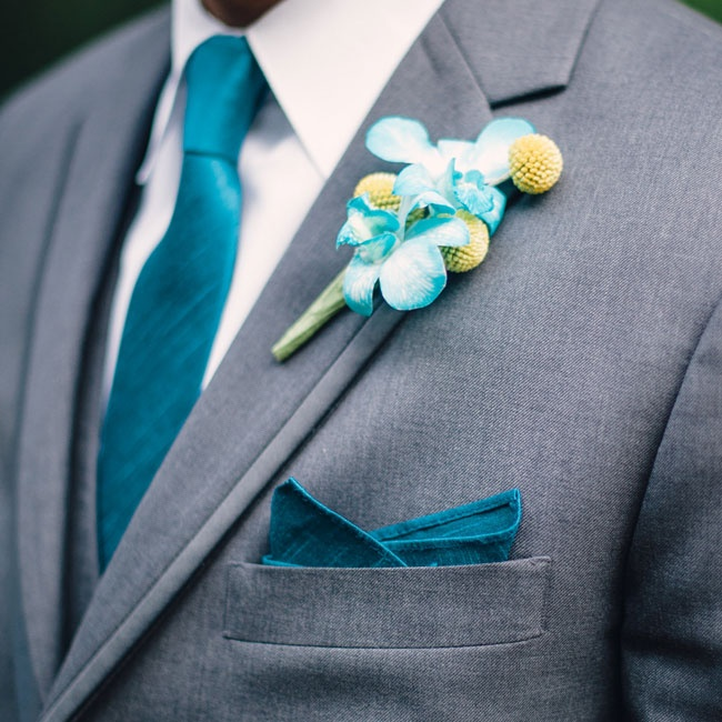 Greg wore a boutonniere made up of vibrant blue orchids paired with yellow craspedia.
