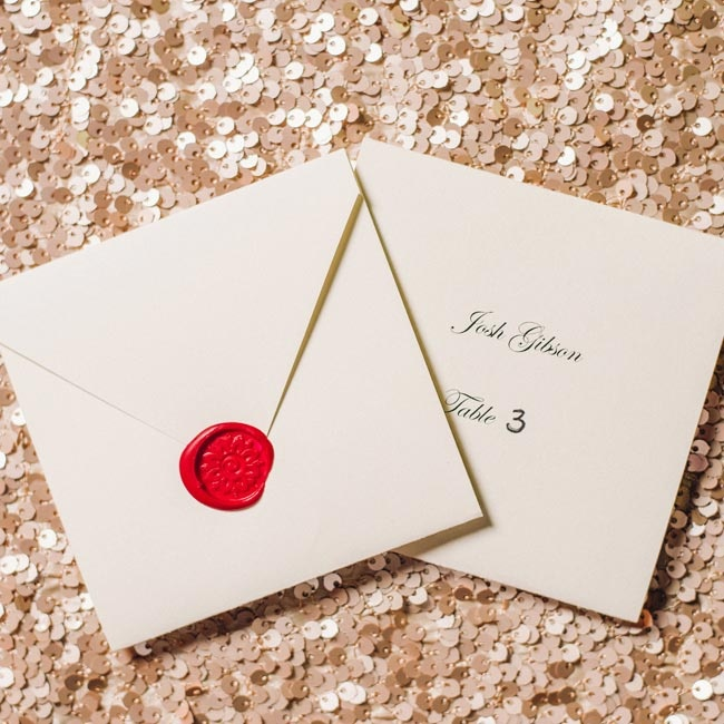 Guests found their table assignments on the formal escort cards -- each was sealed with wax.