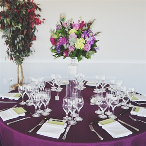 Purple Tables with High Centerpieces