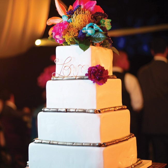 The square cake had pearlized fondant icing with colorful tropical flowers on top.